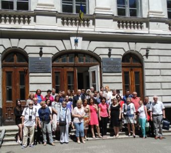 Conference participants near the main building of the university