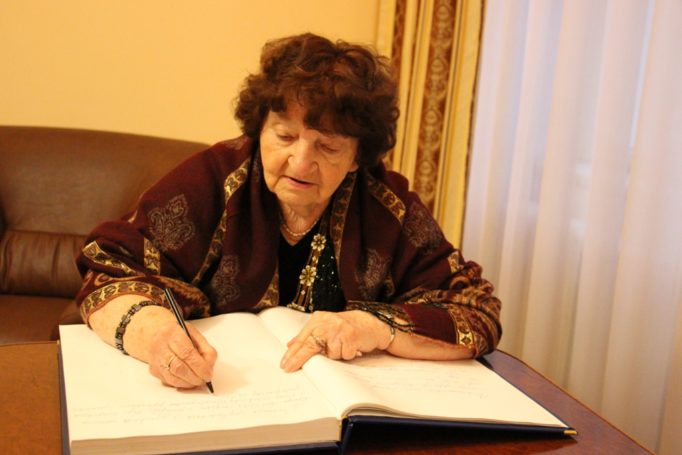"""Professor Bohdana Filts writing in the """"Book of Honorary Guests"""""""