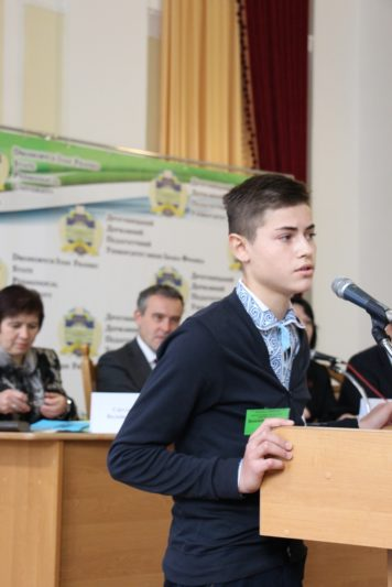 Volodymyr Khorostil, a high school students, delivers his report